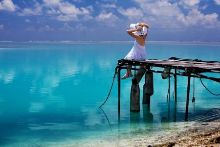 maldives: Happy fashion woman rest on the beach