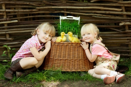 Girls play with duck photo