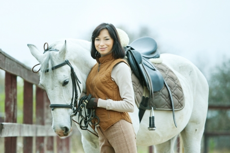 autumn horse: Woman jockey is riding the horse outdoor