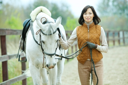 dressage: Woman jockey is riding the horse outdoor