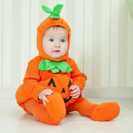 Baby in pumpkin suit on Halloween eve  photo