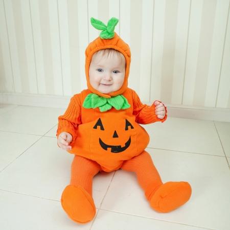 kids costume: Baby in pumpkin suit on Halloween eve