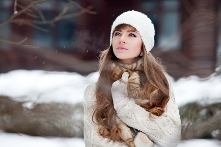winter woman: Attractive young woman in wintertime outdoor
