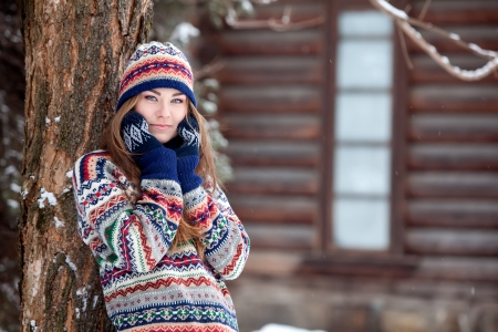 winter fashion: Attractive young woman in wintertime outdoor