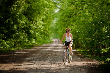 fun at work: Biker on the forest road  Stock Photo