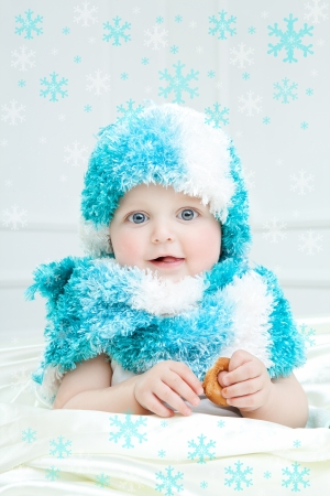 Cute baby at winter background photo