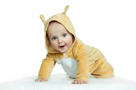 cute baby boy in funny deer costume on white background
