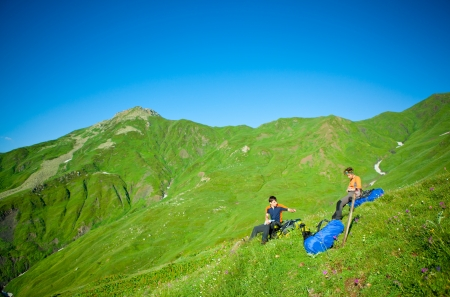 Hiker take a rest during hiking in Caucasus mountains, Georgia photo