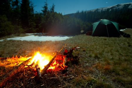 Fireplace during rest near tent at night photo & Evening By The Fire In The Mountains Camping In Tents In The ...