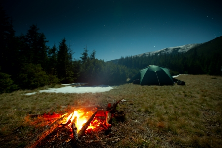 camping tent: Fireplace during rest near tent at night Stock Photo