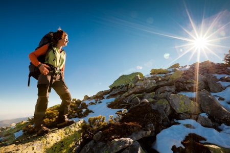 Hiker walking in autumn mountains. Caucasian model outdoors in nature Stock Photo