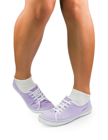 Legs of shy girl at white background Stock Photo