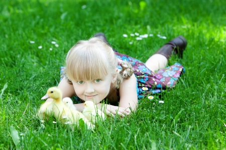 Girls play with chicken and duck photo