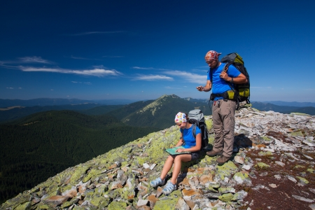 Portrait of couple at the top of the mountain that search for the path photo