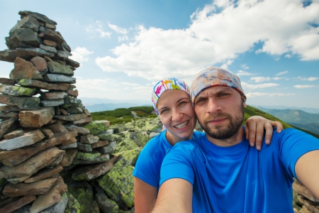 Portrait of couple at the top of the mountain photo