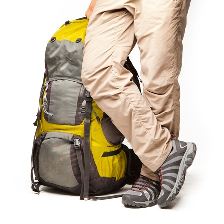 Man stands near packed backpack and ready to go photo