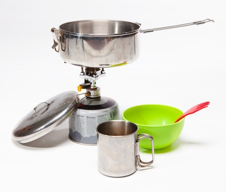 Cooking tourist equipment during camping on white background photo