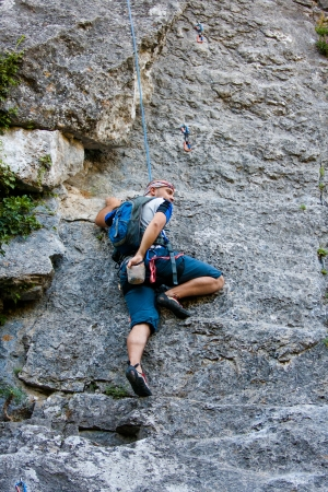 Man practices in climbing at the rock in the Crimea mountains Stock Photo - 18676156