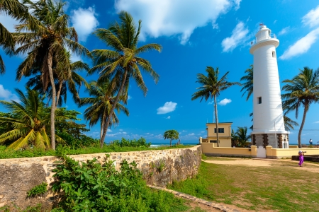 galle: Scenic view at white lighthouse in Galle fort, Sri Lanka during sunny day