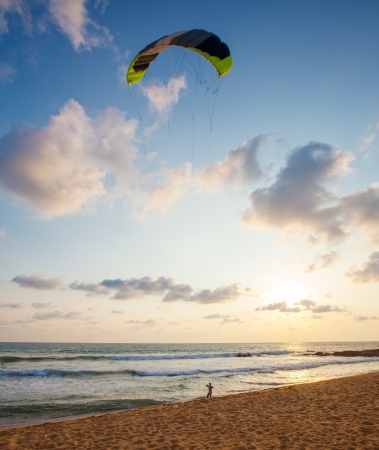 Young woman flying a kite at the seabeach in Sri Lanka photo