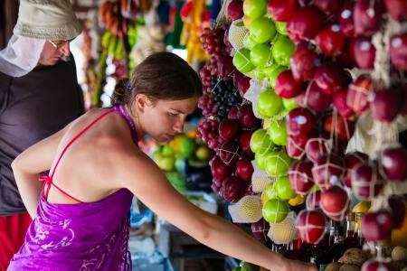 Woman chooses fruits at local market in Sri Lanka Stock Photo