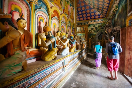 Tourists are visiting at buddist temple  in Sri Lanka photo