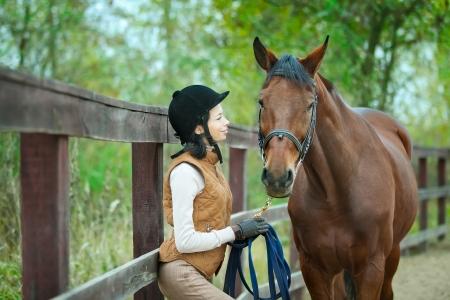 horseback: Woman jockey is riding the horse outdoor