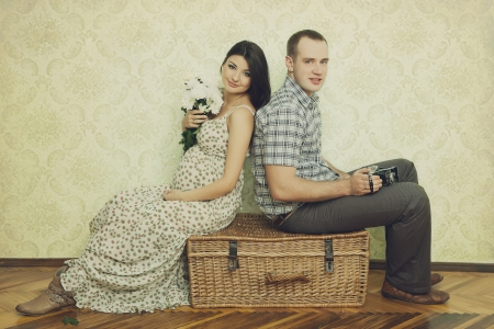 two people fertility: Pregnant couple posing at studio