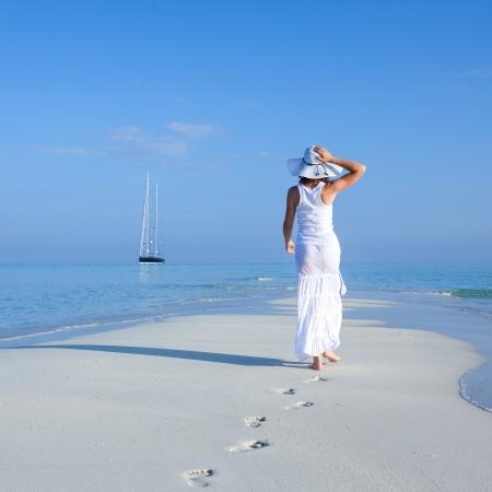 woman beach: Caucasian woman walks along beautiful seashore