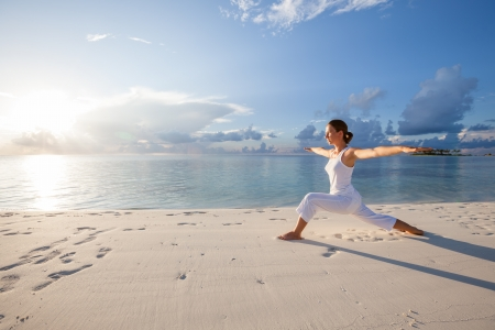 healthy person: Caucasian woman practicing yoga at seashore