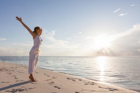 sea sports: Caucasian woman practicing yoga at seashore