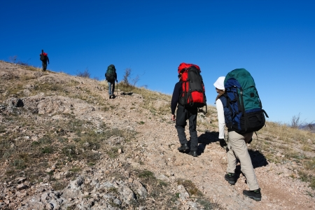 Hiker is climbing mountain in the Crimea mountains photo