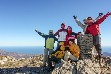 Group of hikers on top of mountain in Crimea mountains Standard-Bild