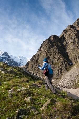 caucasus: Hikier is climbing mountain in Caucasus mountains in Bezengi region, Kabardino-Balkaria, Russia