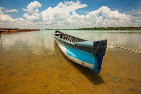 Scenic view at big lake in Sri Lanka with fishmans boat photo