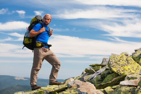 Hiker makes his way in Carpathian mountains Stock Photo
