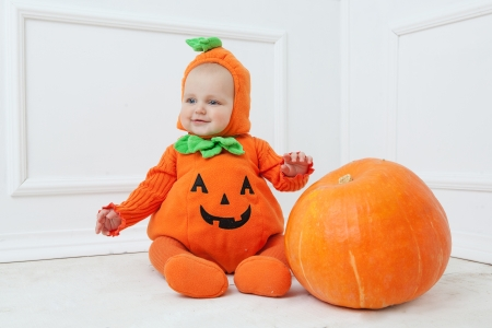 Child in pumpkin suit on white background Stock Photo