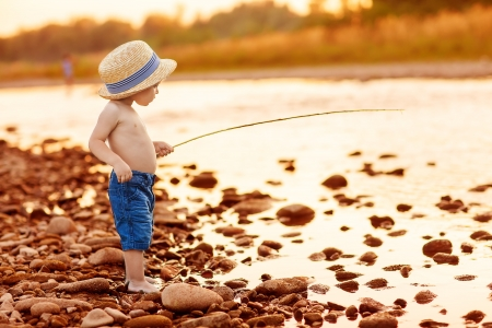 fishing pier: Adorable baby on river with fishing-rod and fishing