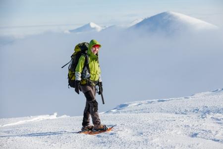 trekker: Woman snowshoeing in winter Carpathian mountains
