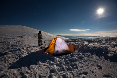 Camping during winter hiking in Carpathian mountains photo