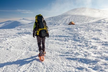 Woman snowshoeing in winter Carpathian mountains  photo