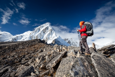 Hiker on the trek in Himalayas, Khumbu valley, Nepal Stock Photo