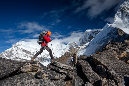 snow climbing: Hiker on the trek in Himalayas, Khumbu valley, Nepal Stock Photo