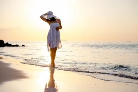 Caucasian woman rests at beautiful seashore Stock Photo