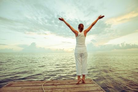 healthy body: Caucasian woman practicing yoga at seashore