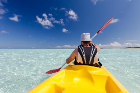 Caucasian man kayaking in sea at Maldives  photo