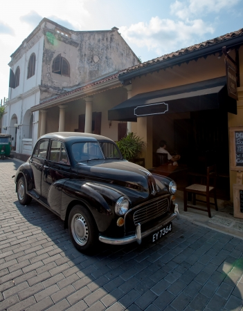 Vintage black car parked at the restaurant in Galle fort, Sri Lanka