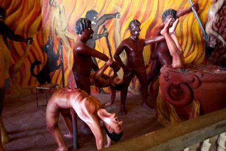 sinner: Hell scenes instalation in buddhist temle in Sri Lanka  Stock Photo