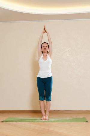 hasta: Caucasian woman is practicing yoga at studio  hasta uttanasana