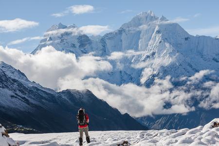 woman hiking: Hiker walks on train in Himalayas